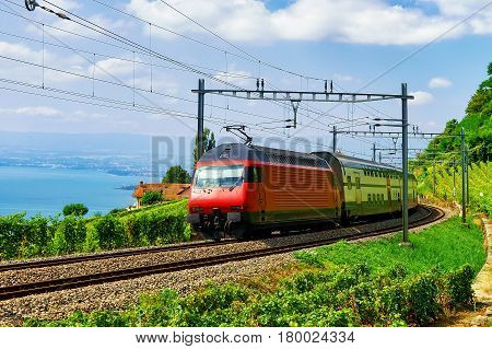 Train And Railroad In Lavaux Vineyard Terraces Lake Geneva Alps