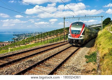 Train At Vineyard Terrace Of Lavaux At Lake Geneva Alps