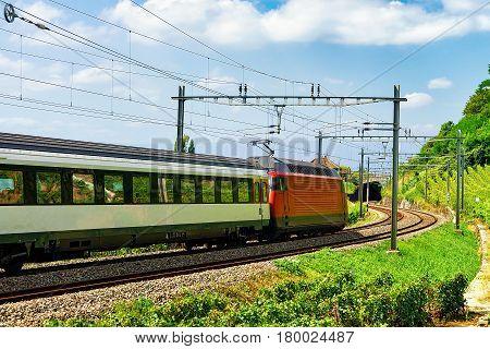 Train On Railroad Near Lavaux Vineyard Terraces