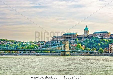 Buda Castle And Chain Bridge Over Danube River In Budapest