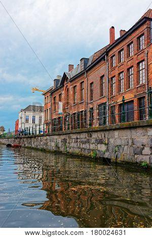 Buildings On Graslei And Korenlei Over Lys River In Ghent