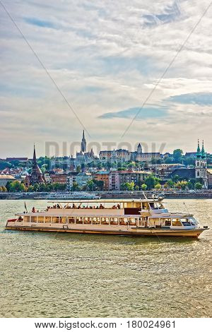 Ferry At Danube River And Buda City Embankment In Budapest