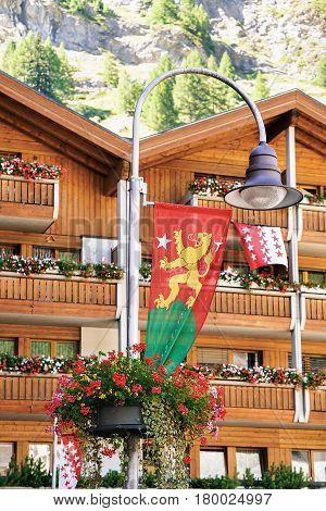 Flags And Chalets In Resort City Zermatt