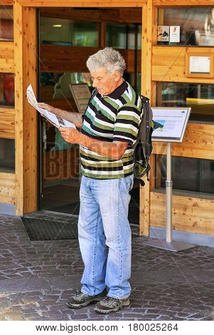 Man Looking Into City Map