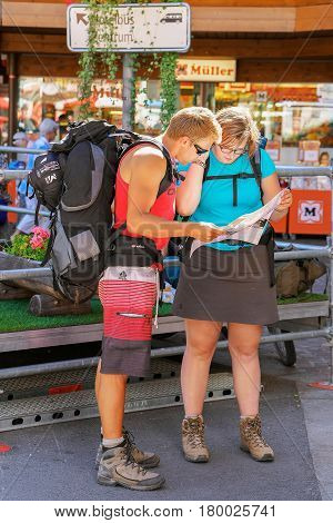 Tourists Backpackers Look Into City Map