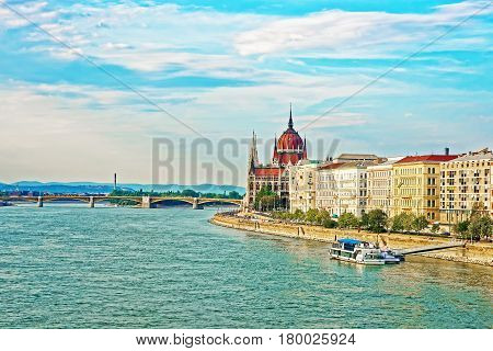 Water Boat In Danube River And Hungarian Parliament House
