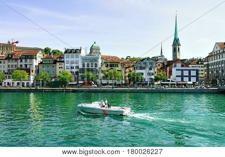 Fraumunster Church And Motor Boat At Limmat Zurich