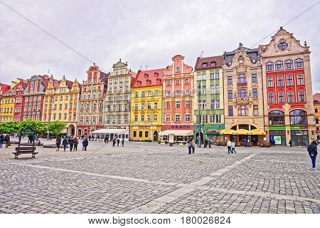 People In Market Square In Old City Center Of Wroclaw