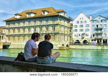 Zurich Switzerland - September 2 2016: People relaxing at Old Town Hall in Limmat River embankment in Zurich Switzerland