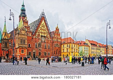 Tourists At Old Town Hall On Market Square In Wroclaw