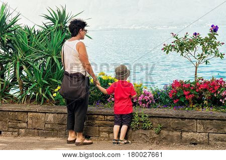 Mother And Son At Embankment Of Geneva Lake In Montreux