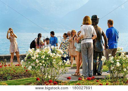 People At Charlie Chaplin Statue At Geneva Lake In Vevey