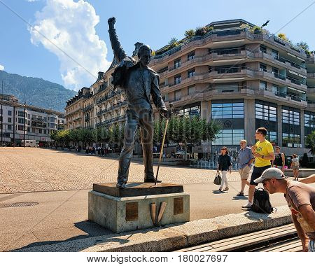 People At Freddie Mercury Statue At Geneva Lake Riviera In Montreux