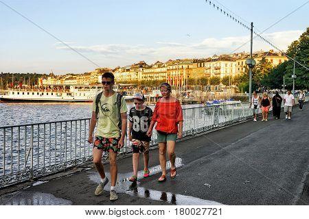 People At Embankment Of Geneva Promenade Du Lac