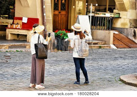 Asian Women Tourists On Kramgasse Street In Bern