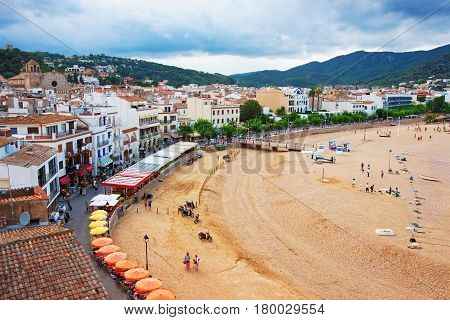 Beach With People In Tossa De Mar On Costa Brava