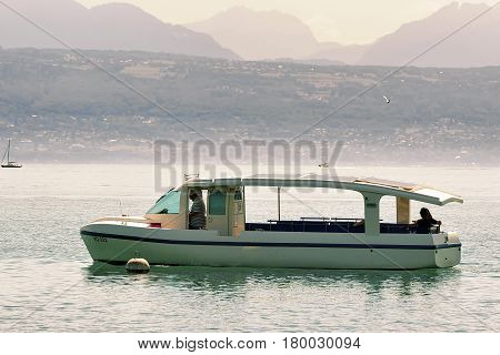 Motor Boat With People On Lake Geneva In Lausanne