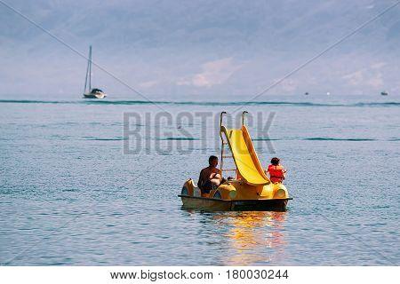 People In Catamaran At Lake Geneva In Lausanne