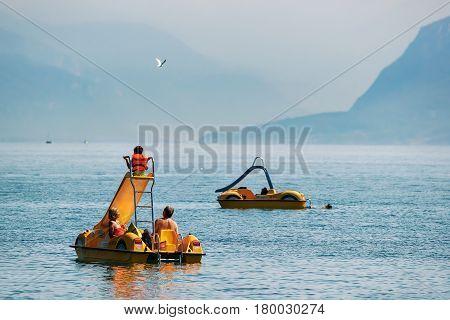 People In Catamarans At Geneva Lake Lausanne