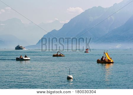 People In Catamarans On Lake Geneva In Lausanne