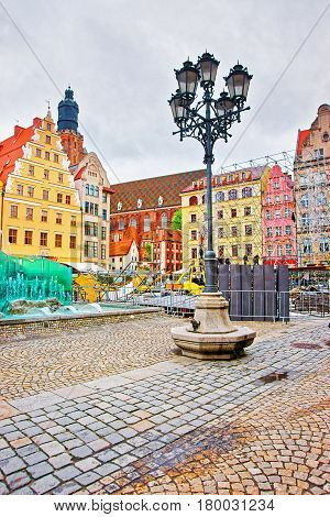 Fountain at the Market Square of Wroclaw Poland. Tower of St Elizabeth Tower on the background