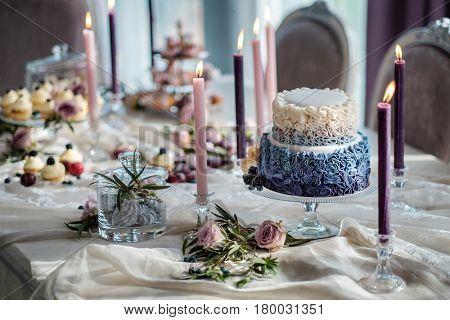 Delicious sweets and cake served on a table of luxurious interior