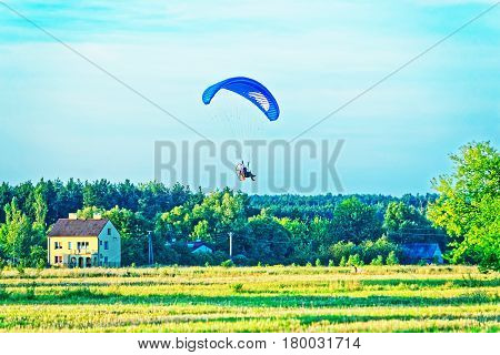Paraglider Flies Over With His Parachute In Poland