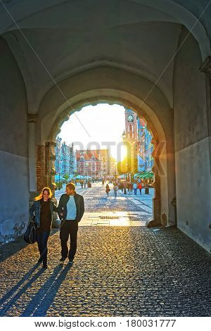 People At Arch In Old Town In Gdansk