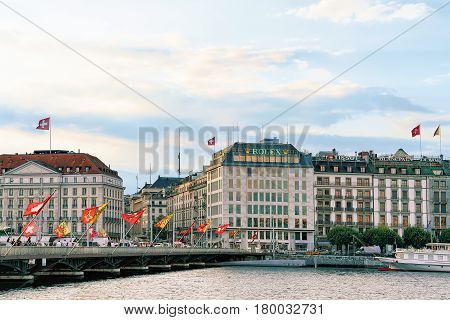 Geneva Lake And Mont Blanc Bridge Swiss Flags