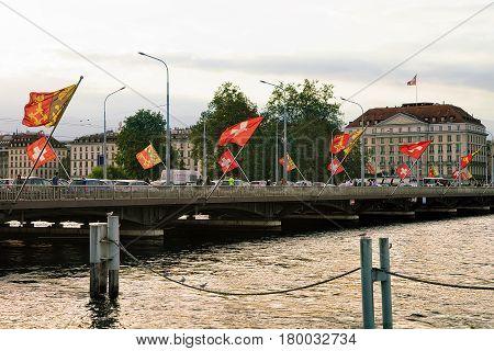 Geneva Lake And Mont Blanc Bridge With Swiss Flags Switzerland