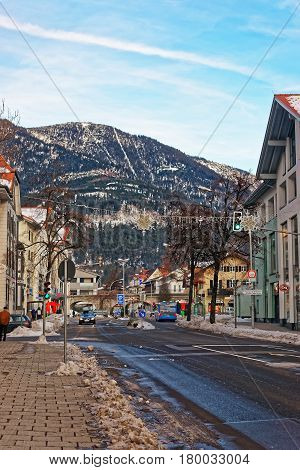 Street Houses And Alpine Mountains In Winter Garmisch Partenkirchen