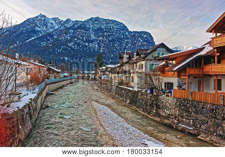 Alps Partnach River And Wooden Chalets At Garmisch Partenkirchen