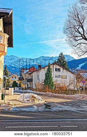 Street With Chalets And Alps Garmisch Partenkirchen