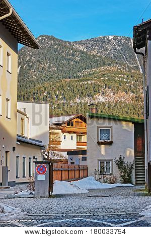Street With Chalets And Alpine Mountains In Winter Garmisch Partenkirchen