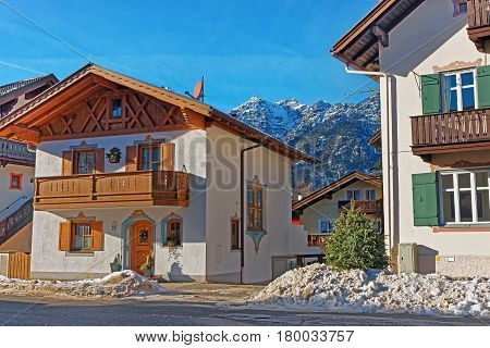 Street With Chalets And Alps At Winter Garmisch Partenkirchen