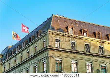 Swiss Flags On Top Of Building In Geneva