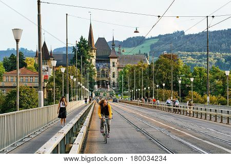 People On Kirchenfeld Bridge And Historical Museum In Bern