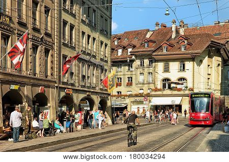 Running Tram And People At Spitalgasse Street In Bern