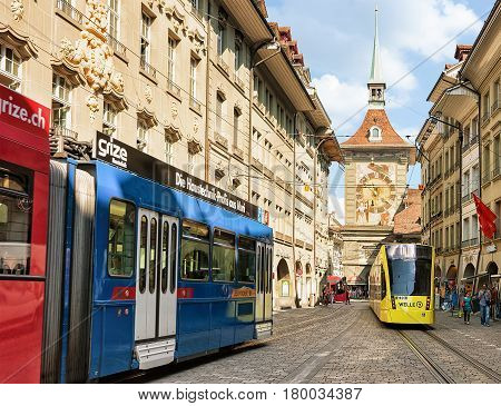 Trams And People At Zytglogge On Kramgasse Street In Bern