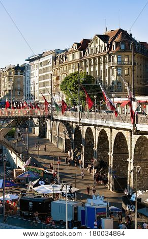 Flon District With Grand Pont Bridge With Flags In Lausanne