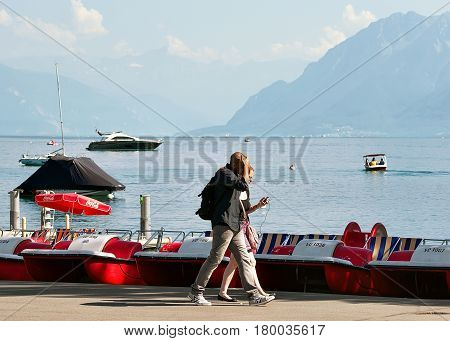 People At Boat Rental Office At Geneva Lake Of Lausanne