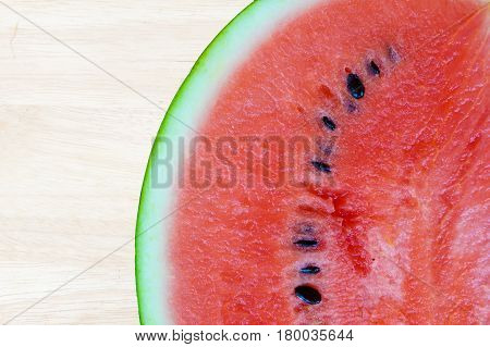 Water melon slice red and fresh with wooden background copy space
