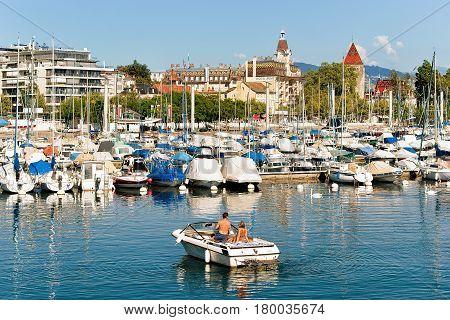 People In Motor Boat At Marina At Lake Geneva Lausanne