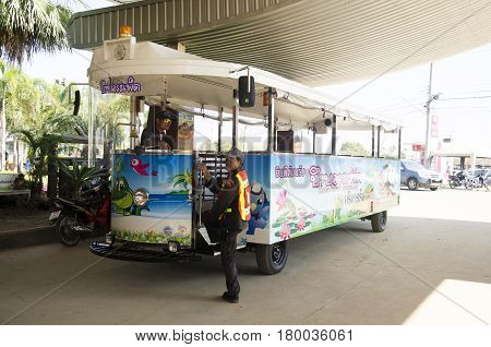 Thai people driving tramcar waiting for send and receive traveler people tour around at Bueng Boraphet public park on December 30 2016 in Nakhon sawan Thailand