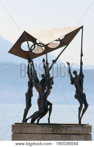Sculpture Of People Carrying Olympic Flag At Olympic Park Lausanne