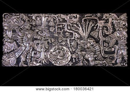 Hand crafted silver artwork depicting pre-hispanic sacrifice scene