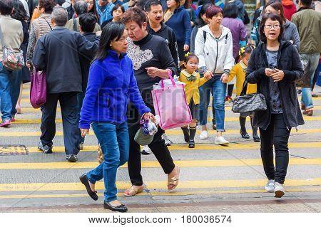 Crowds Of People Crossing A Street In Hong Kong