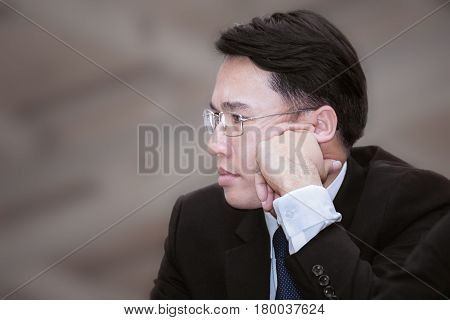 Asian Business Man Thinking About Job Or His Career Path Planing, Business Growth Concept Background