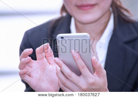 asian business woman happy and smile to use smartphone business shopping concept background
