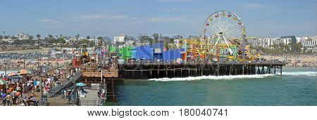 Los Angeles USA - July 14 2013; Panoramic View of the Santa Monica Pier & Beach on a very hot Summer day.